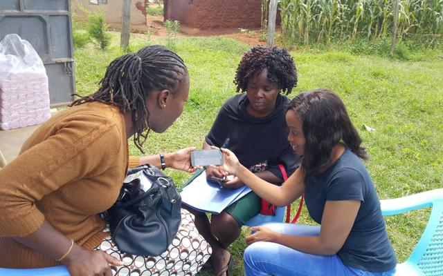 dr diana training field workers on utilizing the mobile application