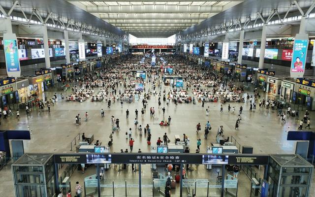 crowd of people queuing in an airport