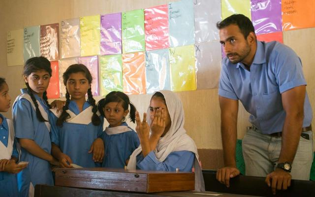 mohsin at his clinic in a classroom