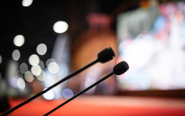 podium stand mic focused with blurred background