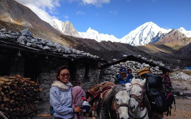 Tsechu in the mountains with two horses