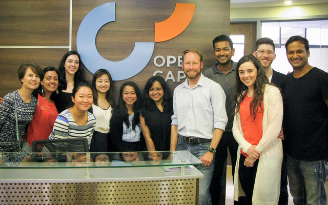 Group of MBAs in reception of Open Capital Advisors
