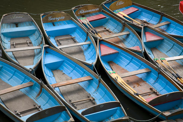 blue rowing boats moored