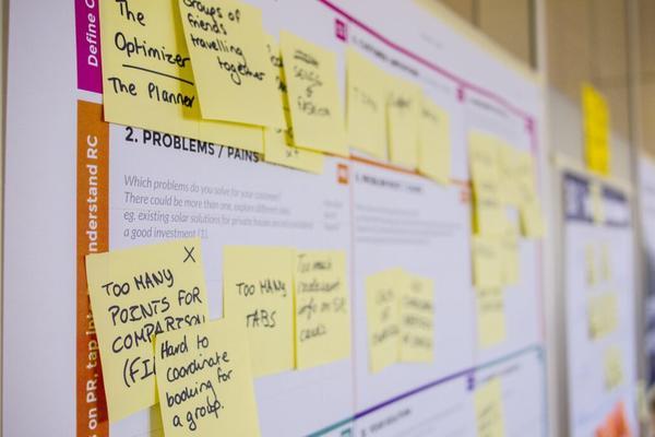 sticky notes on a white board