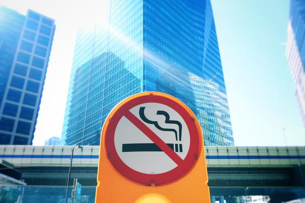 no smoking sign in front of office block