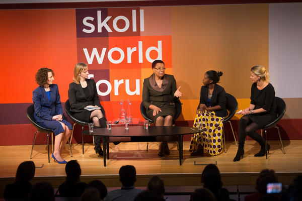 panel of five women on Skoll World Forum stage