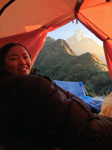 Tsechu in a tent with mountain in the background